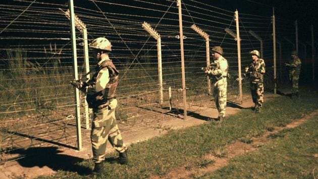 Border Security Force (BSF) soldiers standing guard during a night patrol near the fence at the India-Pakistan International Border at the outpost of Akhnoor sector, about 40 km from Jammu, on October 2, 2016.(HT File Photo)