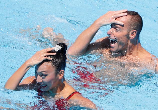 Bill May and Kanako Kitao Spendlove of USA compete. (REUTERS)