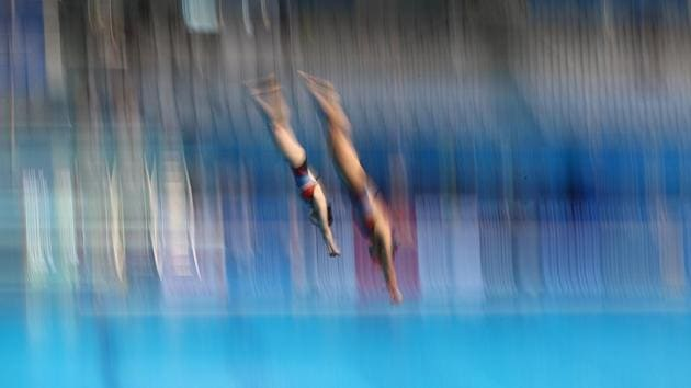 Nami Kim and Nayun Moo of South Korea compete in 3m Springboard Synchro Women preliminary . (REUTERS)
