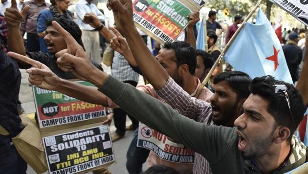 Demonstrators shout slogans as they hold placards during a protest demanding the release of Kanhaiya Kumar, a Jawaharlal Nehru University (JNU) student union leader accused of sedition and support of Umar Khalid and Anirban Bhattacharya who faced charges of sedition, in New Delhi on March 2, 2016.(HT File Photo)