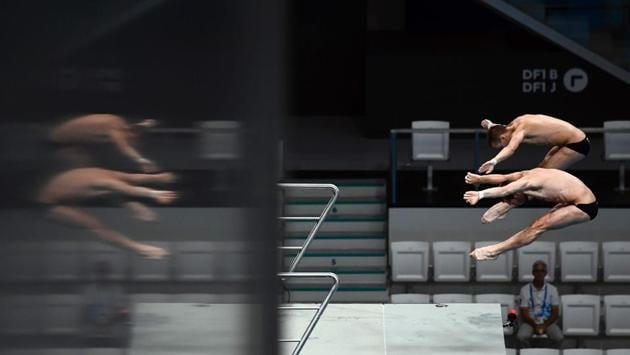Ukraine's Marksym Dolgov and Oleksandr Gorshkovozov compete in the men's 10m platform synchro preliminary round during the diving competition . (AFP)