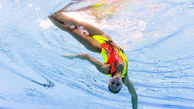 Ukraine's Anna Voloshyna competing in the women's solo free routine preliminary round during the synchronised swimming competition . Some 2,500 athletes are competing in more than 200 events, including synchronised swimming, diving and water polo. (AFP)
