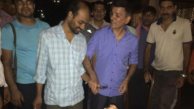 Dr Srikanth Goud (left) returned home on Wednesday night and senior police officers held a cake cutting ceremony for him.(Picture: Sourced)