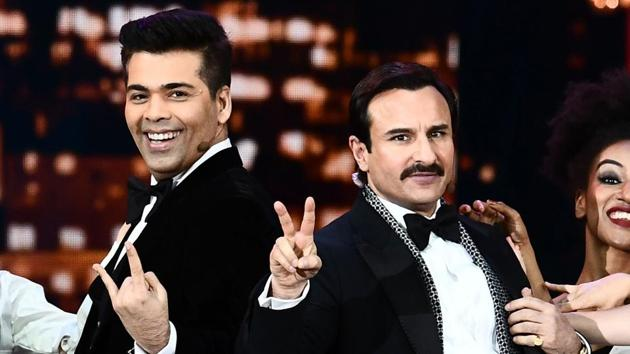 Karan Johar and Saif Ali Khan perform on stage during the IIFA Awards of the 18th International Indian Film Academy.(AFP)