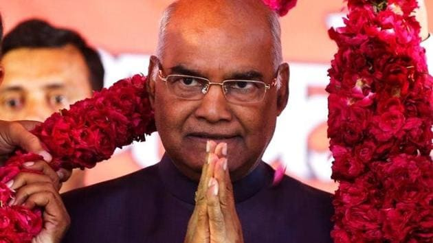 Supporters of Ram Nath Kovind, present him with a garland during a welcoming ceremony as part of his nation-wide tour, in Ahmedabad, July 15.(Reuters)