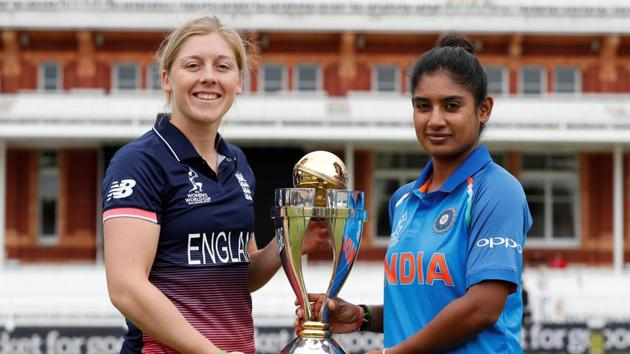 England's Heather Knight and India's Mithali Raj pose with the trophy ahead of the Women's Cricket World Cup final on Sunday.(Reuters)