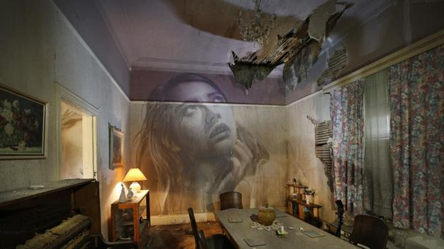 Haunting yet beautiful: A street artist paints walls of abandoned house. See pi...