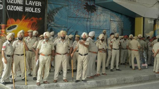 Police on security duty as memorial service of pastor Sultan Masih, who was shot dead outside a church recently, took place at a church in Salem Tabri, Ludhiana, on Monday, July 24.(HT Photo)