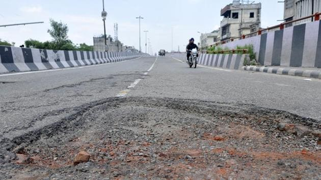 Forget patch work with bitumen, the municipal corporation (MC) has failed to even fill potholes with soil and gravel to provide some relief to the commuters this rainy season.(Gurminder Singh/HT)