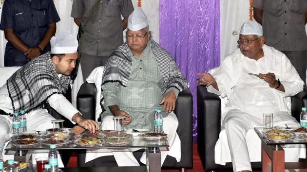 Bihar chief minister Nitish Kumar with RJD chief Lalu Prasad and deputy CM Tejashwi Yadav during a Roza-Iftaar party in Patna on June 19, 2017.(PTI File Photo)