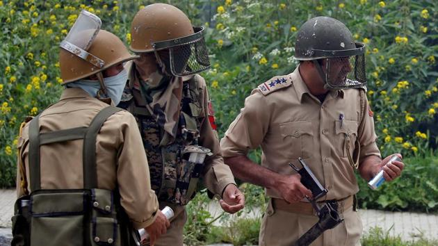 Police officers prepare to fire tear gas during a clash in Srinagar.(Reuters File Photo)