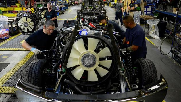Workers assemble a Ford truck at the new Louisville Ford truck plant in Louisville, Kentucky, US.