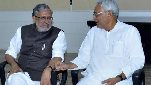 Bihar chief minister Nitish Kumar with senior BJP leader Sushil Kumar Modi at a meeting in Patna on Wednesday.(PTI)