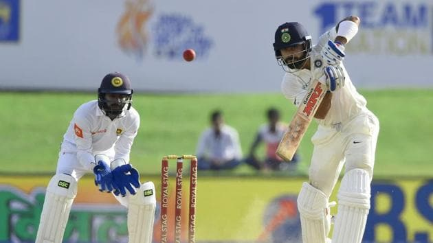 Virat Kohli slammed his 15th fifty while Abhinav Mukund scored his second fifty as India lead at stumps on day 3 was 498. Catch highlights of India vs Sri Lanka, first Test day 3 from Galle here.(AFP)