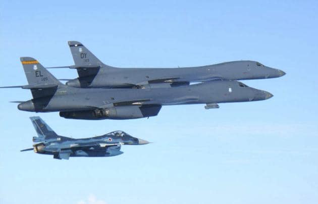 US Air Force B-1B bombers (top) fly with a Japan Air Self Defence Force F-2 fighter jet over Japan's southern island of Kyushu, just south of the Korean Peninsula, during a Japan-US joint exercise on Sunday.(AP)