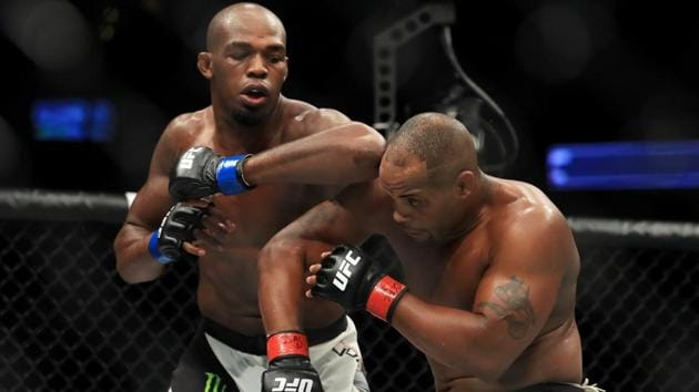 Jon Jones elbows Daniel Cormier during the UFC 214 event at Honda Center on July 29, 2017 in Anaheim, California.(AFP)