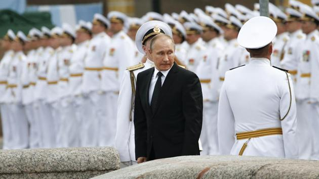 Russian sailors stand in attention as Russian President Vladimir Putin leaves after attending the military parade during the Navy Day celebration in St.Petersburg, Russia, on Sunday, July 30, 2017.(AP Photo)