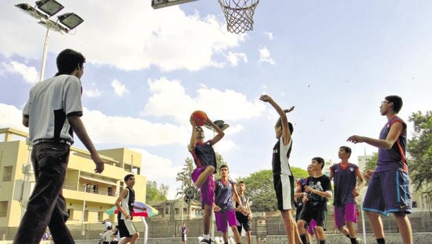 Kids play at a basketball court owned by the Deccan Gymkhana club. In the past few years, several societies have started forming their own teams.(HT PHOTO)