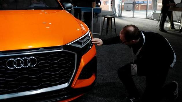 An attendee touches a concept Audi Q8 sports utility vehicle during the annual Google I/O developers conference in San Jose, California, US, May 18, 2017.