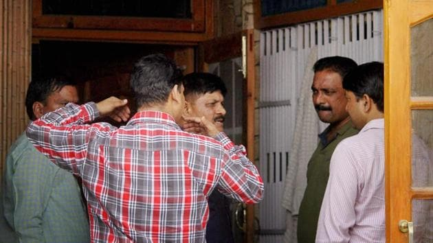 Jammu: National Investigation Agency (NIA) officials conduct a raid at the residence of Devinder Singh Behl, a close aide of separatist leader Syed Ali Shah Geelani, in Jammu on Sunday.(PTI)
