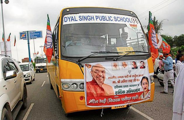 A school bus ferrying people to a BJP rally to welcome Amit Shah in Rohtak on Wednesday.(HT File)