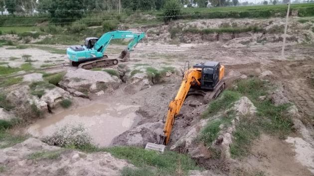 Equipment seized at one of the sand quarries in Ferozepur on Wednesday.(HT Photo)