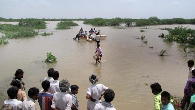 Villagers being moved to safer locations in Barmer.(HT Photo)