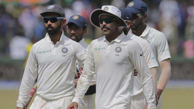 India's Ravindra Jadeja, front right, leaves the field with his teammates after their win over Sri Lanka in their second Test match in Colombo.(AP)