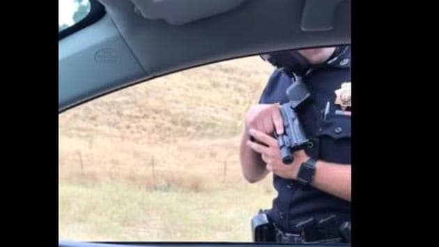 A viral video of a US police officer pointing a gun at a passenger during a traffic stop has divided opinion on social media.(Courtesy: Feo Mas' Facebook page)