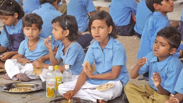 Children have mid-day meal at a government school in Jaipur.(HT File Photo)