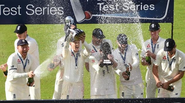 England players celebrate after defeating South Africa 3-1 in the four-Test series at home.(AFP)