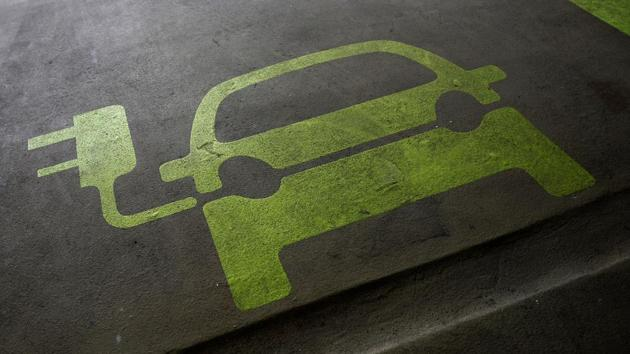 A sign is painted on a parking space for electric cars inside a car park in Hong Kong January 29, 2012.