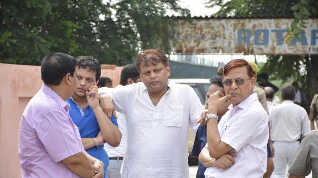 Relatives of IAS officer Mukesh Pandey, who committed suicide in Ghaziabad, arrived at the hospital where a post mortem was conducted. His body was taken to Guwahati.(Sakib Ali)