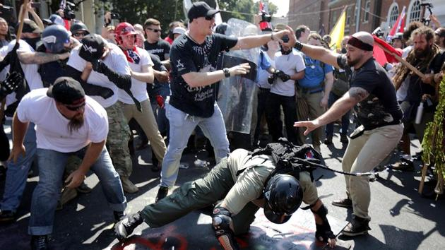White nationalists, neo-Nazis and members of the 'alt-right' clash with counterprotesters as they enter Lee Park during the 'Unite the Right' rally in Charlottesville, Virginia, on Saturday.(AFP Photo)