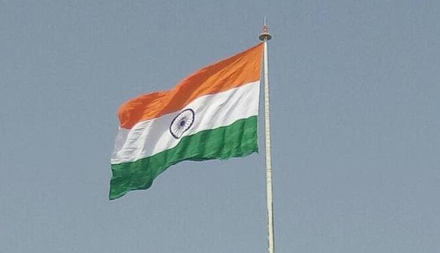 The Tricolour was hoisted at Attari border near Amritsar on Sunday, a day before Pakistan is planning to unfurl a 400-ft flag on their side of the border.(HT Photo)