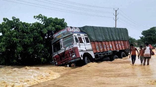 A truck drifts off the submerged NH 28 at flooded Ramgadhwa in East Champaran, Bihar on Monday.(PTI Photo)