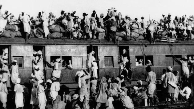 In this September 1947, file photo, hundreds of Muslim refugees crowd on top a train leaving New Delhi for Pakistan.(AP File photo)