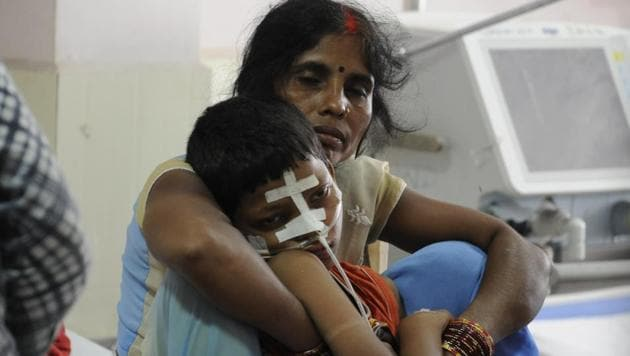 A woman with her son inside the encephalitis ward at the BRD medical centre in Gorakhpur, on Tuesday.(Deepak Gupta/ HT Photo)