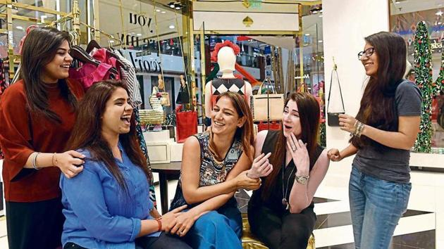 Aaditi Sardana (left),executive retail, and Garima Gakhar (second from left), assistant manager, leasing, with their colleagues at Select Citywalk in Delhi's Saket. Both appreciate the fact that every employee has a voice in their organisation and are not looking for a change in job at the moment.(Saumya Khandelwal/ HT Photo)