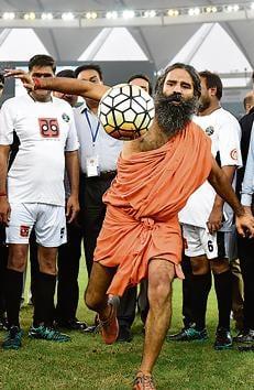 Kicking it: Baba Ramdev during a charitable football match between Indian Bollywood actors and Indian Parliamentarians in New Delhi on July 24, 2016.(Vipin Kumar/HT PHOTO)