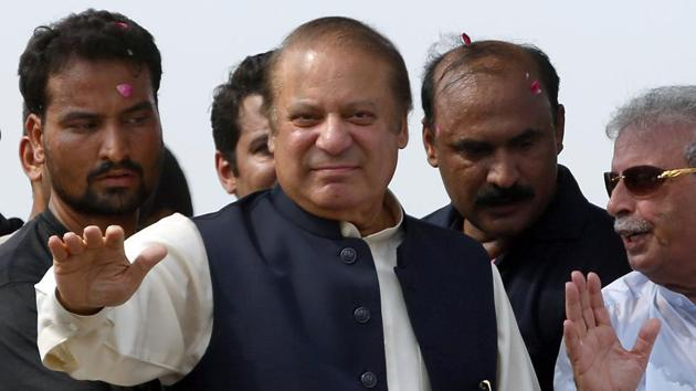 Deposed Pakistani Prime Minister Nawaz Sharif waves to his supporters during a rally in Muridke, Pakistan, on August 12.(AP File Photo)
