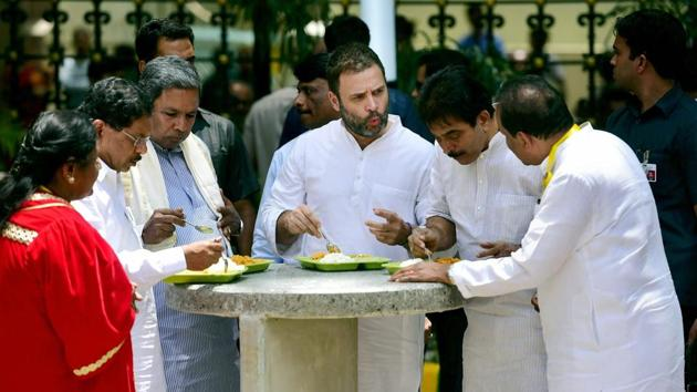 Congress vice president Rahul Gandhi and Karnataka CM Siddaramaiah,among others, eat food at the newly launched 'Indira Canteen' that will provide food at a subsidised rate to the poor, in Bengaluru on Wednesday.(PTI)