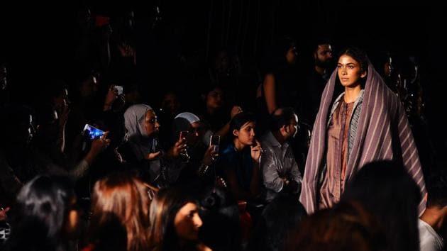 An Indian model showcase creations by designer Gaurav Jai Gupta at Lakme Fashion Week (LFW) Winter /Festive 2017 in Mumbai on August 17.(AFP India)