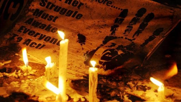 Candle light vigil being held for rape victims, in New Delhi. The Supreme Court ordered the Bihar government to compensate a 35-year-old rape victim who became pregnant as result of the assault.(HT File Photo)