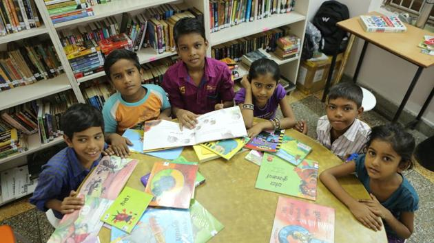 Kids spend time in the reading room of The Community Library Project, Gurgaon.(Manoj Verma/HT Photo)