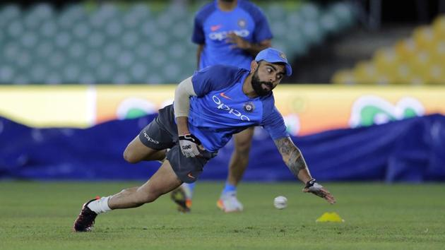 <p>Indian cricket captain Virat Kohli fields a ball during a practice session ahead of their first One-Day International against Sri Lanka in Dambulla.</p> (AP)