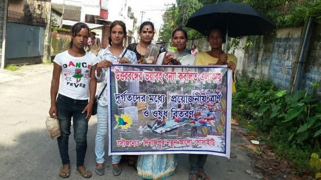 Members of the transgender community pose with one of the posters made for the relief campaign.(HT Photo)