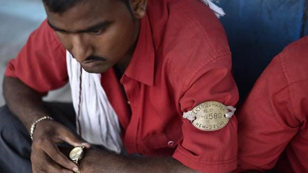 <p>The coolie or train porter in his bright red shirt and copper armband has been ubiquitous at Indian railway stations ferrying luggage to and from trains...