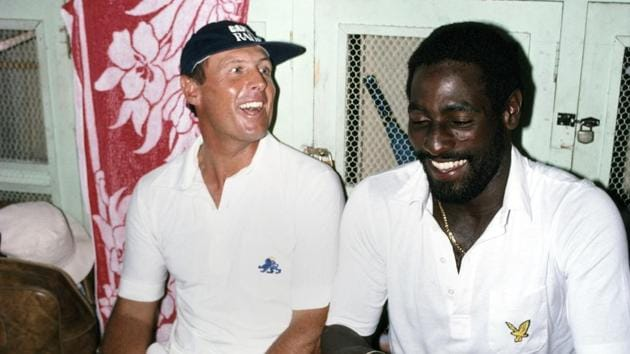 England and Yorkshire batsman Geoffrey Boycott (left) shares a joke with West Indies batsman Viv Richards in the dressing room in Antigua during the 1981 Test series between West Indies and England. Boycott triggered a racism storm with his comments on how the West Indians got knighthood(Getty Images)
