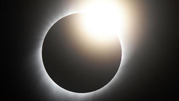 <p>The moon blacked out the sun on Monday as the first coast to coast total solar eclipse in the United States in nearly a century began over the West Coast...